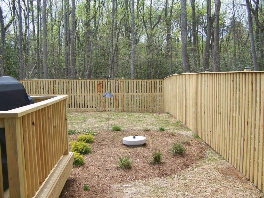 wood fence and wood deck in the garden at Piney Point