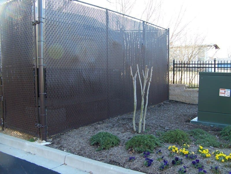 Large tennis court chain linked fence close to Huntingtown