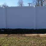 very tall stock vinyl fence close to Calvert County