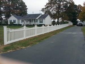 White Vinyl scalloped picket fence installed