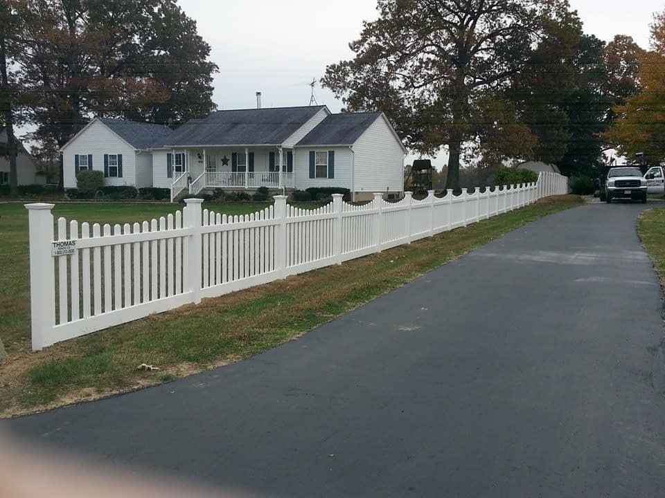White Vinyl scalloped picket fence installed in Southern MD